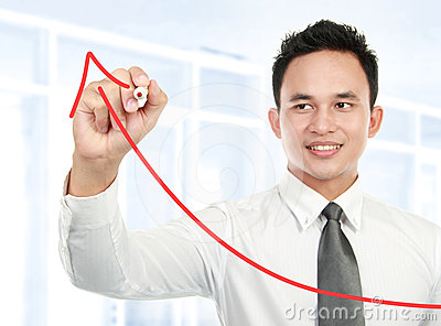 Young businessman drawing statistic