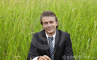 Young businessman in the fields