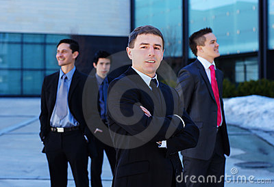 A young businessman in front of his team