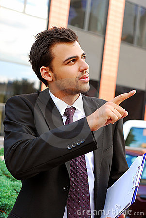 Young businessman in the front of office