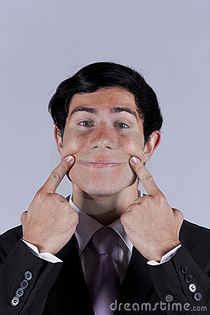 Young businessman with a funny face