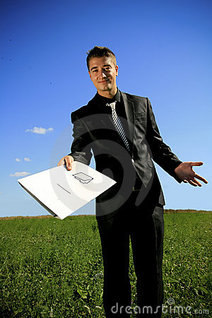 Young businessman handing a folder
