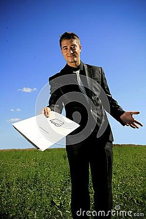 Young businessman handing a folder