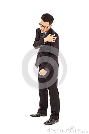 Young businessman having  shoulder pain