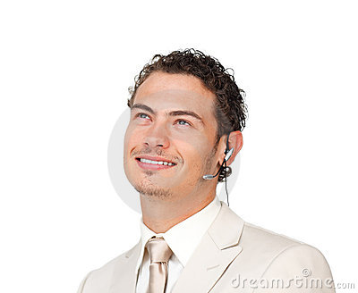 Young businessman with headset on looking up