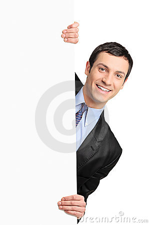 Free Young Businessman Holding A Blank Billboard Royalty Free Stock Images - 18058019