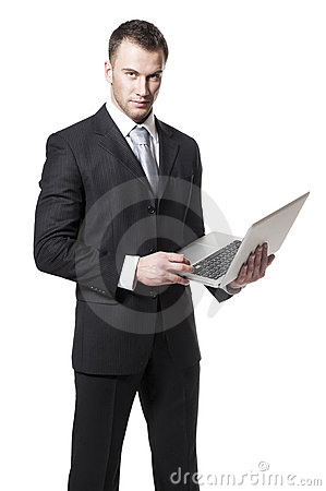 Young businessman holding laptop