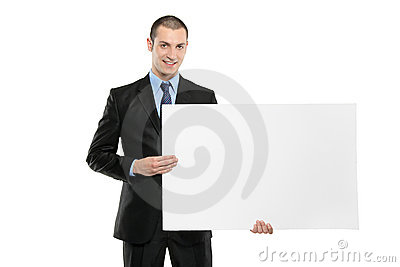 A young businessman holding a white blank card