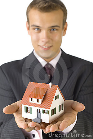 Young businessman with house