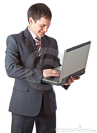 Young businessman with laptop.