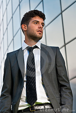 Young businessman looking future modern building
