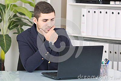 Young businessman looking at the laptop