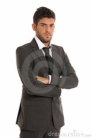 Young businessman looking serious arms crossed