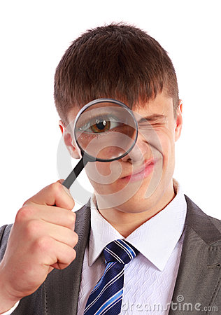 Free Young Businessman Looks Through A Magnifying Glass Royalty Free Stock Image - 28537136