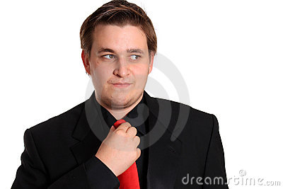 Young businessman loosening tie