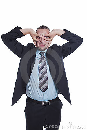 Young businessman make focus sign with his hands