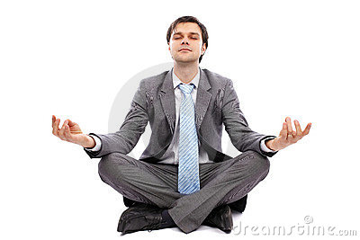 Young businessman meditating