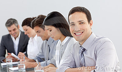 Young businessman in a meeting with his team
