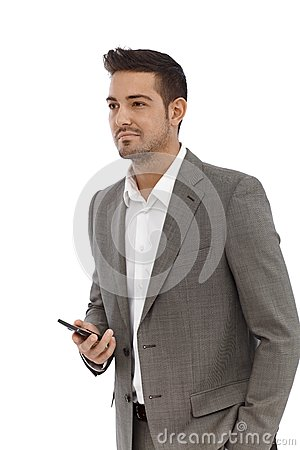 Young businessman with mobile