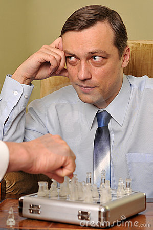 Free Young Businessman Playing Chess Royalty Free Stock Photography - 13033167