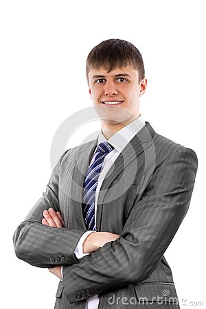 Young businessman poses confidently with crossed a