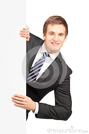 Free Young Businessman Posing Behind A Blank Panel Royalty Free Stock Photo - 29075795
