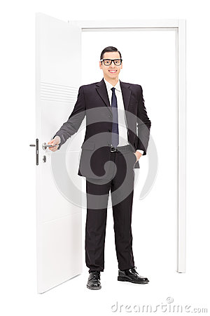 Free Young Businessman Posing In Front Of A Door Stock Photography - 53387592