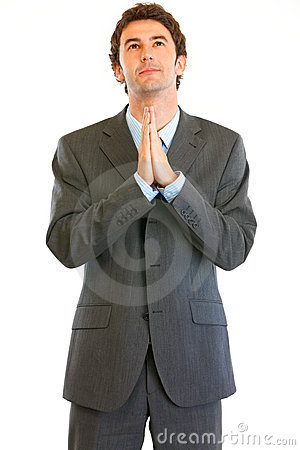 Young businessman praying for success
