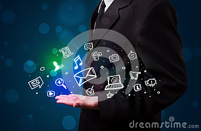 Young businessman presenting colorful glowing social media icons