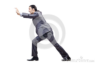 Young businessman pushing  obstacles