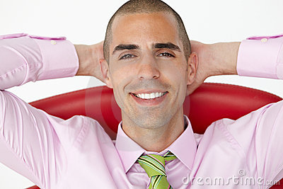 Young businessman relaxing in chair