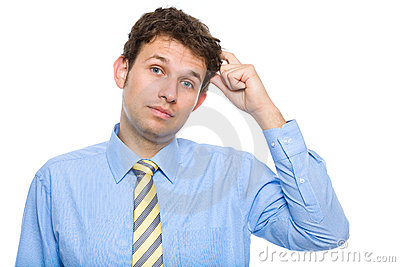 Young businessman scratching his head, confused