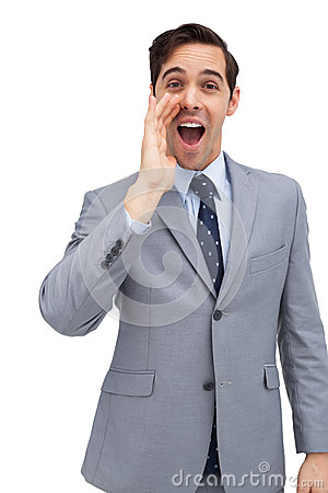 Young businessman shouting at the camera