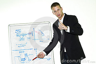 Young businessman showing something on white board