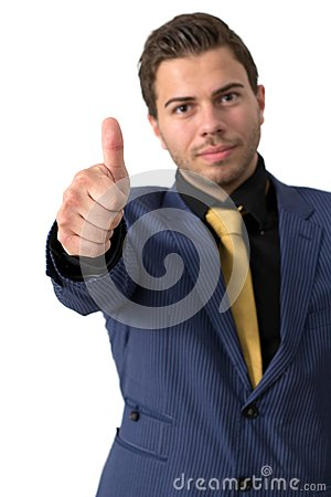 A Young businessman showing thumb up