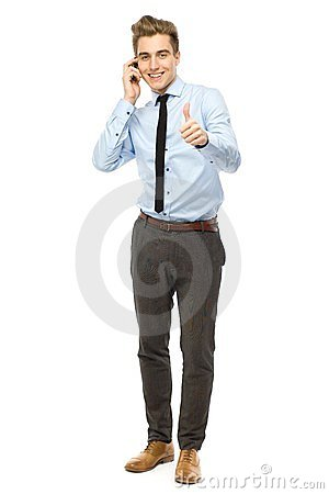Young businessman showing thumbs up