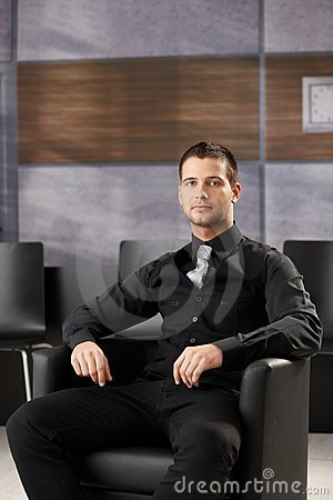 Young businessman sitting in meeting room