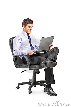 Young businessman sitting in office chair