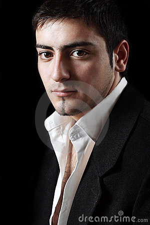 A young businessman staring at you