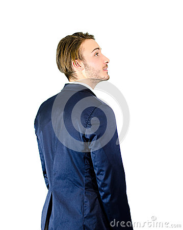 Young businessman or student looking up to a side