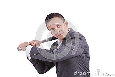 Young businessman swinging baseball bat