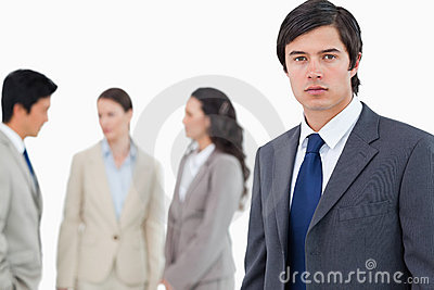 Young businessman with talking associates