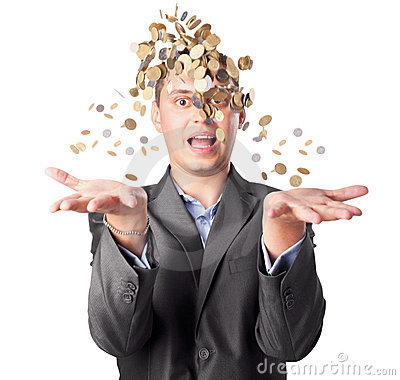 Young businessman throws up many coins