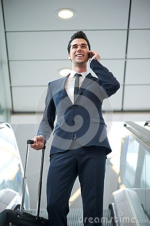 Young businessman traveling with bag and phone