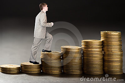 Young  businessman upstairs career from money