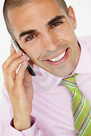 Young businessman using cellphone
