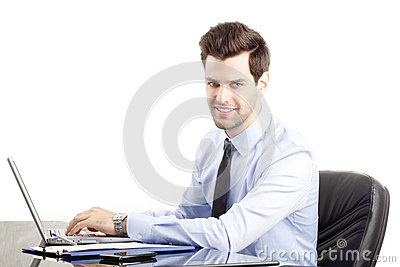 Young businessman using laptop. White background