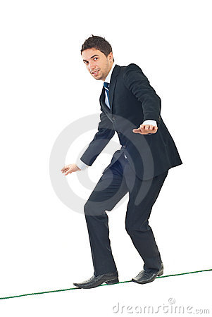 Free Young Businessman Walking On Tightrope Royalty Free Stock Photo - 17331815