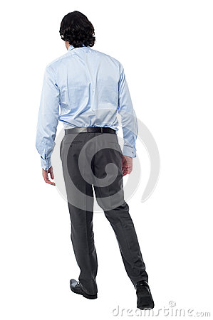 Young businessman in walking posture