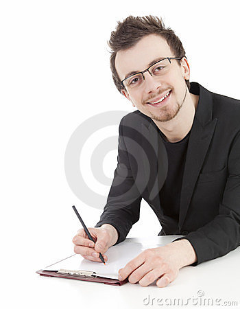 Young businessmsn writing on clipboard